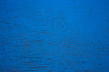 the surface is painted with blue paint, old wall