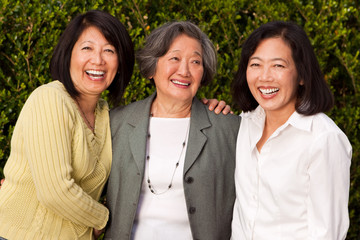 Mature Asian mother and her adult daughters.