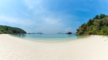 Bruer Island, amazing island from southern of Myanmar. A stunning seascape with turquoise water and white sand beach against blue sky at Bruer Island. Panoramic view