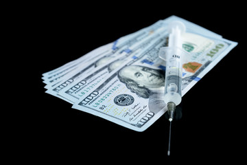 Drug heroin, syringes, pills and dollar money on black background with copy space. Crime and addiction concept