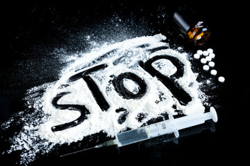 "Drugs, syringe and pills. The inscription ""stop"" - concept stop drug addiction"