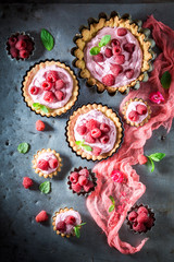 Delicious and tasty tarts with raspberries and mascarpone