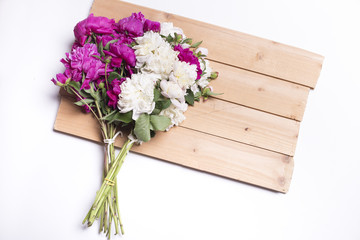 flowers bouquet on wooden background.copy space