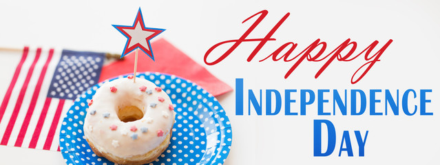 independence day, celebration, patriotism and holidays concept - close up of glazed donut with american flag and star decoration on plate at 4th july party