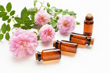 Bottles of essential rose oil for aromatherapy.