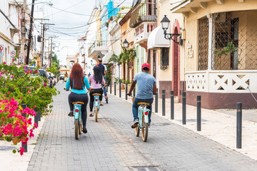 SANTO DOMINGO, DOMINICAN REPUBLIC - AUGUST 8, 2017: People on bicycles on a city street. Copy space for text.