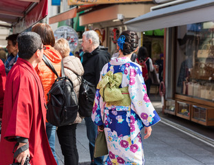 TOKYO, JAPAN - OCTOBER 31, 2017: People on a city street. Copy space for text. Back view.
