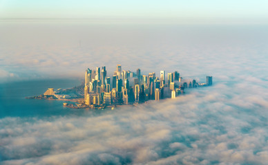 Aerial view of Doha through the morning fog - Qatar, the Persian Gulf