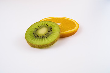 A slice of orange and kiwi on a light background