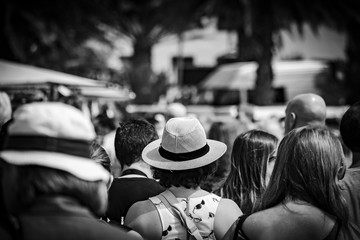 Hat in the crowd, back, black and white