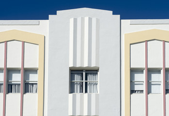 Typical pastel-colorfed 1930s Art Deco architecture with palm trees in Miami, Florida