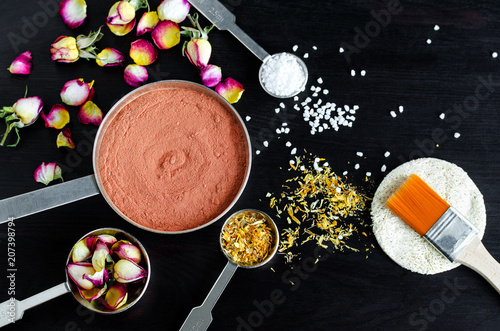 Small scoops with moroccan red clay, dry rose buds, marigold flowers