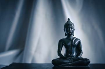 black statue of Buddha