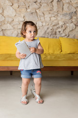 Toddler wearing Mom's high-heel shoes and handbag