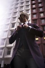 Fashion blogger Steve Tilbrook adjusting his tie