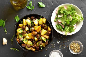 Roasted potatoes with mushroom and sausage