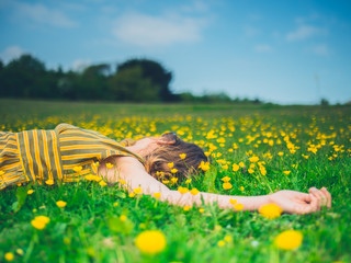 Young woman lying in meadow