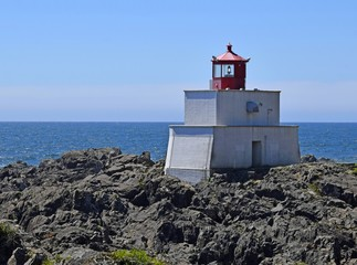 Amphitrite Point Lighthouse overlooking the Barkley Sound , Ucluelet Vancouver Island British Columbia Canada