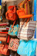 Leather and textile bags in tunisian market.
