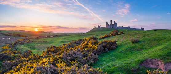 Dunstanburgh Castle Panorama at Sunset / Located between Craster and Embleton in Northumberland on the North East Coast