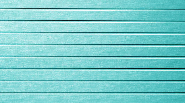Plastic siding wall texture in cyan color.