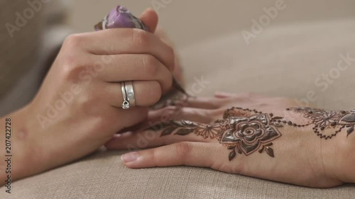 Close Up Shot Woman S Hand With A Henna Cone Doing Beautiful Mehndi