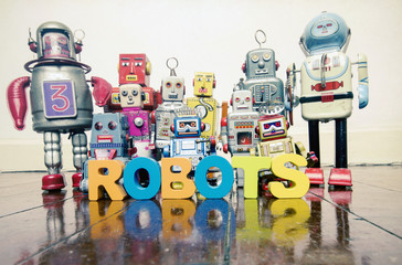Wall Mural - the word  robots with wooden letters and retro toy robots  on an old wooden