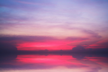 reflection of sunset heap cloud on sea water surface