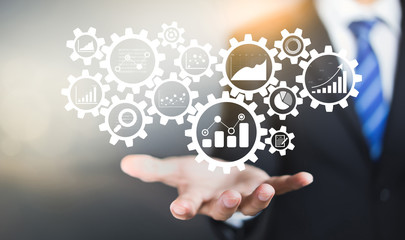 Gear cogs is connected to financial charts, KPI, and graphs. Business Process Data Analysis concept