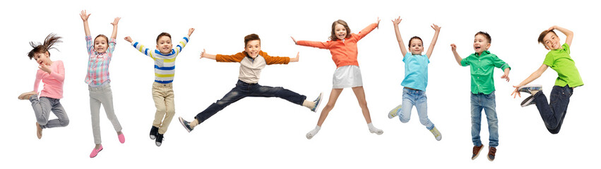 happiness, childhood, freedom, movement and people concept - happy kids jumping in air over white background Wall mural