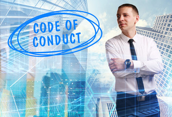 The concept of business, technology, the Internet and the network. Young businessman showing inscription: Code of conduct