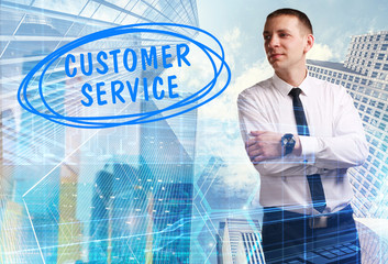 The concept of business, technology, the Internet and the network. Young businessman showing inscription: Customer service