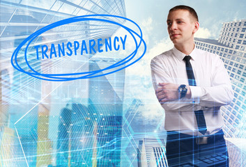 The concept of business, technology, the Internet and the network. Young businessman showing inscription: Transparency