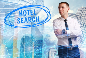 The concept of business, technology, the Internet and the network. Young businessman showing inscription: Hotel search