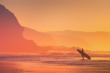 surfer silhouette at the sunset