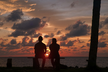 A couple during the sunset from coco cabana, Miri, Borneo