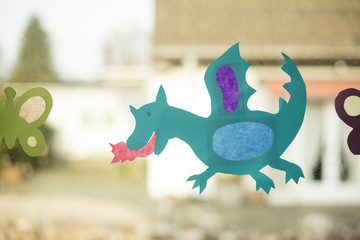 Shape of a dragon made with paper as handicraft activity for children