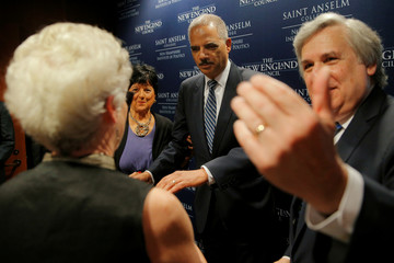 Former U.S. Attorney General Eric Holder greets audience members in photo line before a Politics and Eggs event at the New Hampshire Institute of Politics at St. Anselm College in Manchester
