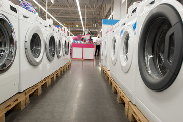 New washing machine of the latest generation, dryer and other domestic appliance equipment in the store. Copy space