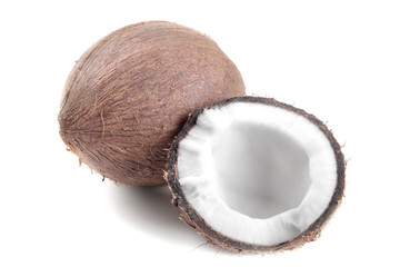 Whole coconut and half coconut on a white background isolated