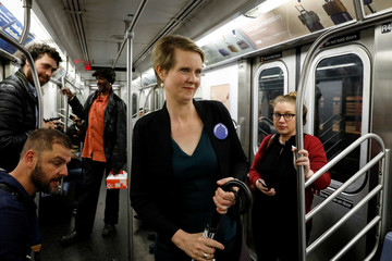 Actor and New York governor candidate Cynthia Nixon rides the subway following a campaign event in New York