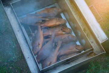 Fish smoking in smokehouse
