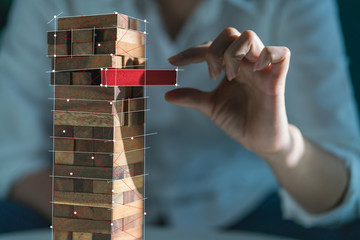 hand pull important color block from balance wooden stack business strategy and risk management control concept