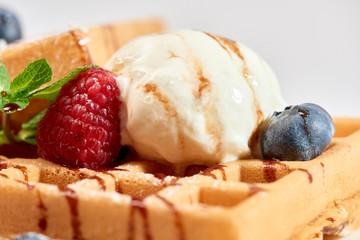 Dessert dish. Belgian waffles with ice cream, blueberries and raspberries.