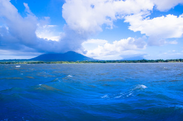 Volcan Concepcion, Isla Ometepe in Nicaragua. View from the ferry with cloud around the top of the mountain