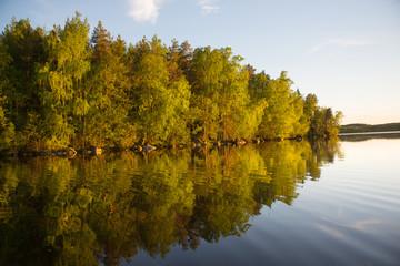 Golden reflection on Finnish lake