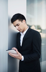 Young business man surfing on tablet