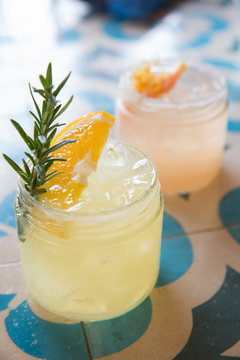 Organic margarita garnished with rosemary and orange in Mexico