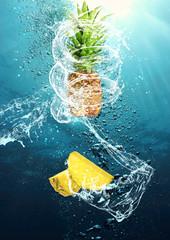 Splashing pineapple into water