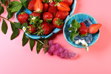 Fresh cut strawberries in a blue plate with ice mint pink flowers see more mightylinksfo